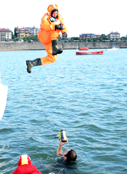 Tim Troy jumps into the sea during sea survival training at Porto Deportivo in Getxo, Spain.                                             (onEdition)