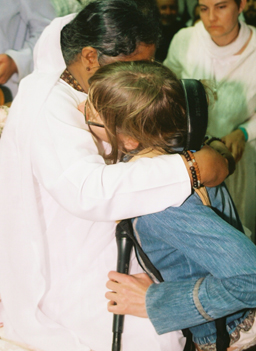 Clark and Amma in full embrace.                                             (Janani Noia, M. A. Center (Copyright 2006))
