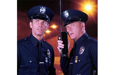 "A still from the old cops show ""Adam 12.""                                             (--)"