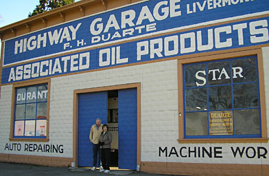 Slide 1 Bill Junk and Marie Abbott of the Livermore Heritage Society stand outside the Duarte Garage in Livermore, California.                                             (Pat Loeb)