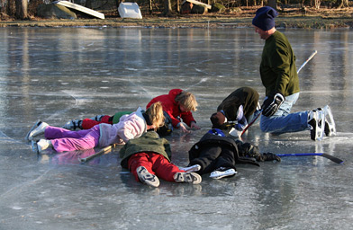 "Neighborhood kids checking out the ""solar system"" beneath the ice.                                             (Stacy Fowle)"