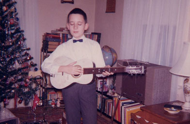 "Author Luc Sante with his new guitar in Christmas 1964. Sante's treasured ""The New Christy Minstrels"" album is at his feet.                                             (Luc Sante)"