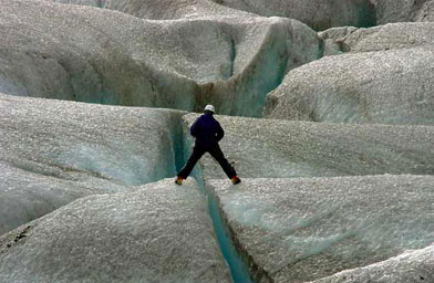 Weigel stands over a crevasse on the Mendenhall Glacier.                                             (Beth Weigel)