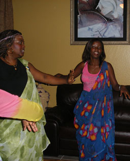 Nadia Kassongo and Ines Kazeneza dance a traditional Burundian dance in Jeanne's living room.                                             (Ann Heppermann and Kara Oehler)