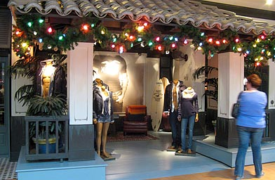 The unusual entrance to Hollister doesn't allow you to see into the store. There are no signs to advertise sales. In fact, the only place the Hollister name appears is on a single surfboard in the corner.                                             (Ochen Kaylan)