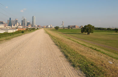Service roads run atop the 29-foot-high levees north of downtown Dallas.                                             (Julia Barton)