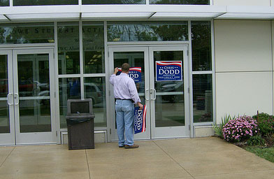 A Chris Dodd supporter takes down signs after a sparsely attended campaign event at Iowa Wesleyan College.                                             (John Moe)