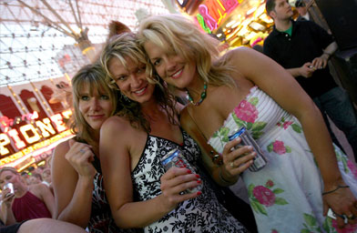 Country music fans pose during the daytime Academy of Country Music All Star Concert at the Fremont Street Experience in Las Vegas, Nev.                                             (Michael Buckner / Getty Images)