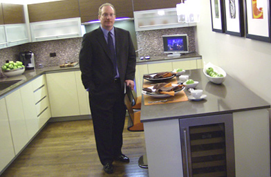 Gordon Absher shows off the kitchen of a City Center condo.                                             (Michael May)