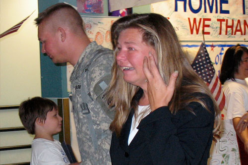 A happy mother picks up her son returning from Iraq on R&R leave.                                             (Julia Barton)