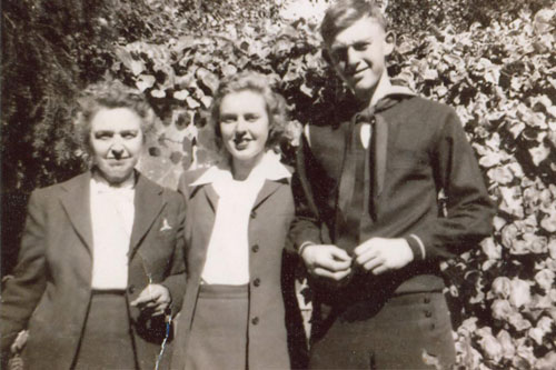Krissy Clark's father, Lester Clark, in his navy uniform, sometime during World War II.  His sister and mother are beside him.                                             (Krissy Clark)