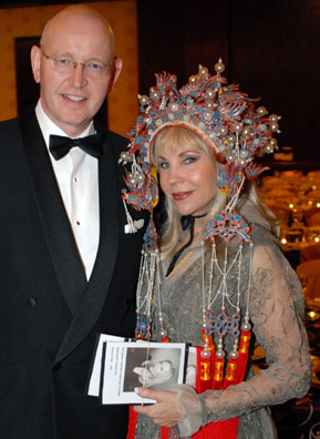 Willem Plegt, General Manager of InterContinental Hotel with Carolyn Farb, who is wearing a Chinese headdress at the Chinese Community Center gala.                                             (Colt)