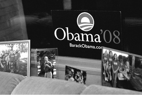 Gracia and Jim Willis have a collection of Obama political artifacts and family photographs on the windowsill in their living room.                                             (Sarah Mercier)