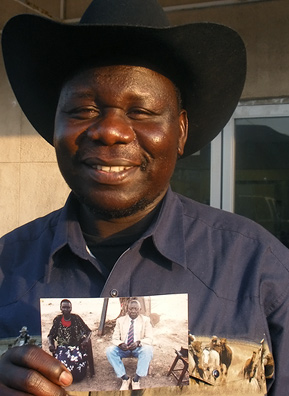 Kaunda Mogga, owner of the Sudanese Center, holds the thing he brought with him: a photo of his parents.                                             (Kara Oehler & Ann Hepperman)