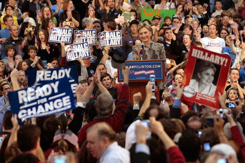 "Presidential candidate Sen. Hillary Clinton (D-NY) acknowledges a cheering crowd of supporters after she is declared the winner of the New Hampshire primary. The word ""change"" is on her campaign signs and banners as well.                                             (Chris Hondros/Getty Images)"