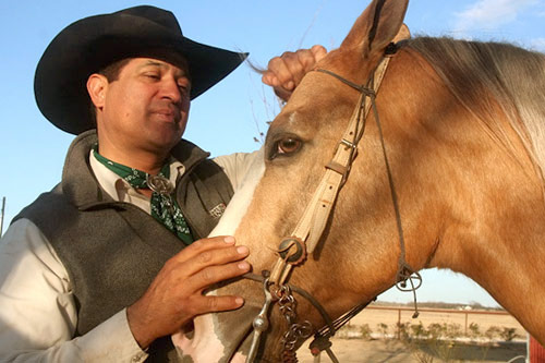 Jerry Diaz with Bandito, one of his horses.                                             (Michael May)