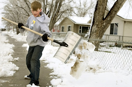 A Montana boy shovels snow after a spring storm.                                             (Stephen Brashear / Getty Images)
