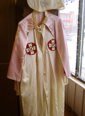 This robe was one of a collection of items from the estate of the late Robert E. Miles auctioned off in Howell, Mich., in 2005. Miles was a grand dragon in the Ku Klux Klan. The auction garnered national interest and helped cement Howell's reputation as a KKK town.                                             (Desiree Cooper)