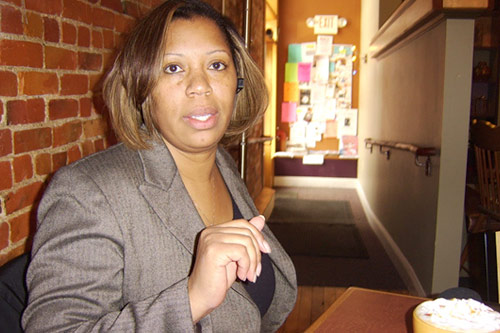Candye Hinton takes a break from her real estate practice for a cup of coffee at Uptown Coffeehouse in Howell. Hinton is the only black realtor in Livingston County, Mich. This month, she became the first African American president of the Livingston Diversity Council.                                             (Desiree Cooper)