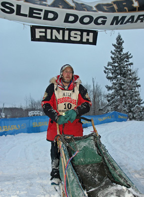Four days after beginning the 2006 Beargrease Sled Dog Race, Keith Ali crosses the finish line as its winner.                                             (Kit Larson)