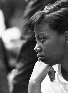 A young woman listens to speakers during a civil rights rally on August 28, 1963 in Washington, D.C.                                             (Courtesy National Archive/Newsmakers)