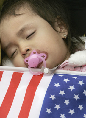 A baby sleeps during a rally for immigrant family and worker rights in New York City's Union Square in May 2007.                                             (STAN HONDA/Getty Images)