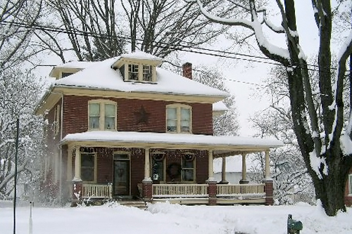 Nephin-Bish's home during the last snowfall in Lancaster, Pa.  Nephin-Bish says high heating oil costs make it tough to keep it warm.  Many of their weekends are spent at home, reading or watching movies.                                             (Courtesy Eileen Nephin-Bish)