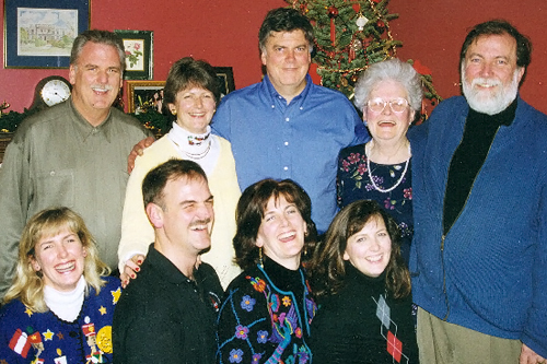 Marie McNulty and brood during Christmastime 1998 (top left to right): Kevin, Ann, Bryan, Marie, Tim. Bottom left to right: Maureen, Pat, Eileen and Colleen.                                             (Courtesy Maureen Saxton)