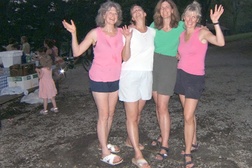 The McNulty sisters are sweaty after their turn to cook during a family reunion camping trip in August 2006. From left to right: Ann, Colleen, Eileen and Maureen.                                             (Courtesy Maureen Saxton)