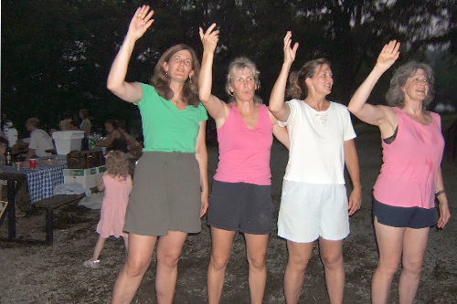 The McNulty sisters demonstrate how the royals wave to their adoring subjects.                                             (Courtesy Maureen Saxton)