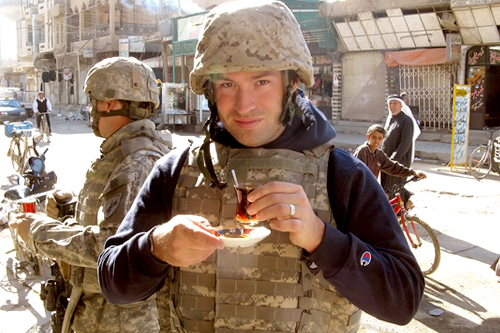Reporter Adam Allington enjoys a tea break with a group of soldiers in downtown Ramadi.                                             (Sgt. Clyde Rhoads)
