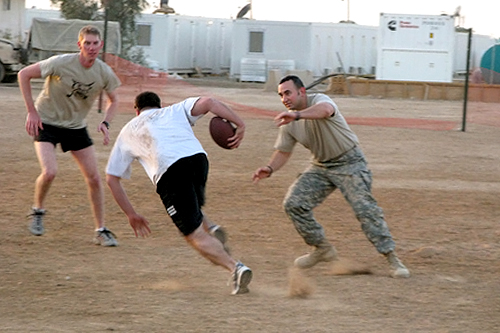 Soldiers from Missouri playing a pick-up game of touch football.                                             (Adam Allington)