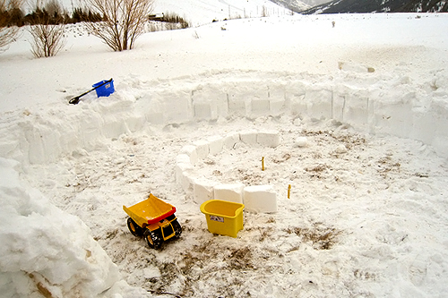 Latham Jenkins from Jackson Hole, Wyo., is building an igloo with his three-year-old son.                                             (Latham Jenkins)