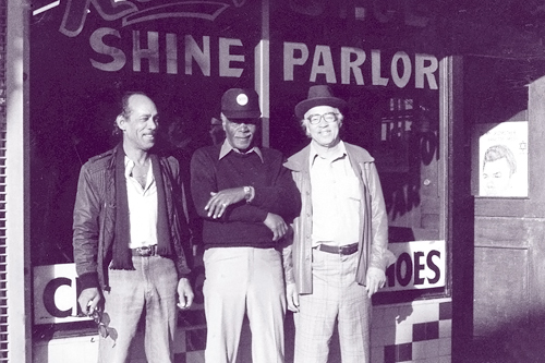 Photo collector Red Powell (right) and friends in front of his shoe-shine parlor in 1970. Powell's business was located in San Francisco's Fillmore District, once an epicenter of San Francisco's African-American community. The walls of Powell's shop were lined with photos depicting the neighborhood's hey-day as an international jazz destination.                                             (Reprinted with permission of Chronicle Books, courtesy of The Red Powell/Reggie Pettus Collection.)