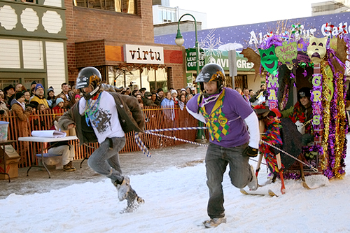 Winner of both the People's Choice and Most Colorful awards, Moose Lodge's Mardi Gras team makes safety a priority as they sprint down Anchorage's Fourth Avenue wearing helmets.                                             (Photo Credit: Anchorage Convention &Visitors Bureau/Cady Lister)