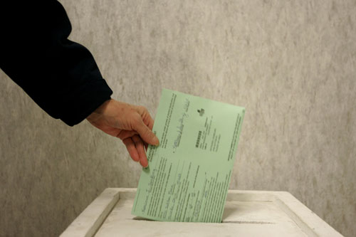 A woman drops her ballot in a voter box at One Government Center Mar. 2, 2008 in Toledo, Ohio.                                             (J.D. Pooley/Getty Images)