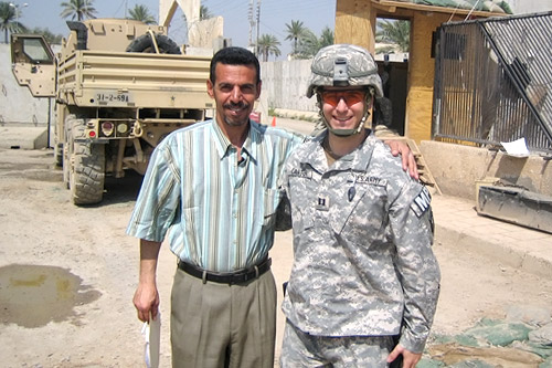Capt. Phillip Carter with Dr. Thaer Kudier al-Qasi, an Iraqi law professor who served as a translator and legal adviser for Carter's team and their work with the Iraqi police and courts.  Thaer was killed by Al Qaeda in Mesopotamia in November 2006, two months after Carter returned home from duty.                                             (Courtesy Phillip Carter)