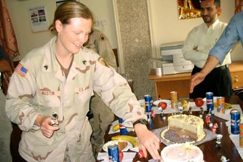 Sandi Austin served in Iraq as a sergeant with the 445th Civil Affairs Battalion, in Samarra and Mosul. This is a photo of her birthday party in Mosul's City Hall in May 2004. She now lives in Monterey, Calif., with her newborn baby daughter.                                             (Courtesy Sandi Austin)