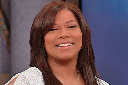 "Queen Latifah admitted to buying herself wedding rings (both of which she wears on her ring fingers), and married herself. During a recent broadcast of the Oprah Winfrey Show, Latifah said that anyone marrying her would have to ""really earn that spot as my mate.""                                             (Courtesy Oprah.com)"