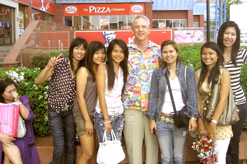 Peter Maxon, independent producer David Maxon's father, pictured with young Thai women set to go bowling as a get-to-know-you event.                                             (Courtesy Paul Maxon)