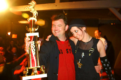 "Patrick Grover shows off his first-place Grilled Cheese Invitational trophy. His creation, ""The Mussolini,"" won the Kama Sutra category.                                             (Kevin Rolly)"