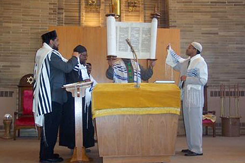 Rabbi Capers Funnye and the assistant rabbis hold the Torah at a recent Saturday service at Temple Beth Shalom in Chicago's South Side.                                             (Photo courtesy Temple Beth Shalom)