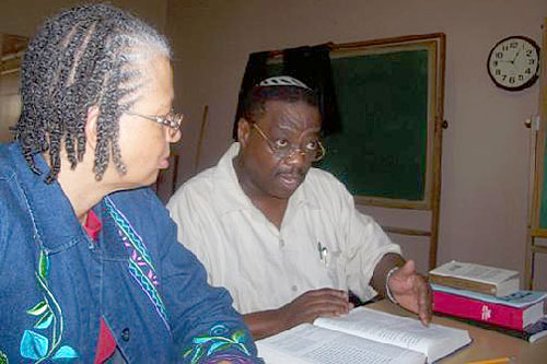 Rabbi Capers Funnye studies with temple member Dinah bat Levi.                                             (Photo courtesy Temple Beth Shalom)