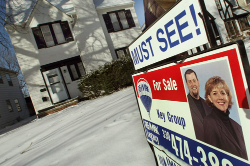 A sale sign sits in front of a home in the Shaker Heights section of Cleveland, Ohio. Cleveland is the epicenter of the nation's foreclosure crisis -- bad news for nearby homeowners and cities nationwide, because they lead to falling property values and increased crime.                                             (Timothy A. Clary)