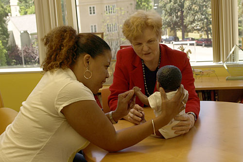 Mary Jane Rotheram-Borus uses a doll to explain a point about parenting skills.                                             (UCLA Center for Community Health)