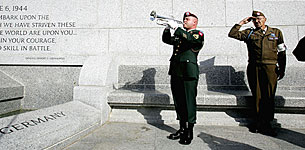 Playing taps at the World War II Memorial