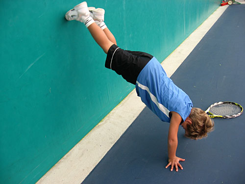 Jan has a tendency to goof-off, like any 6-year-old. Here, he shimmies up a wall backwards to attempt a handstand.                                             (Rene Gutel)