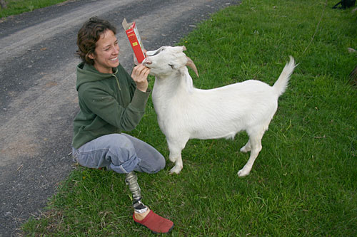 "Jenny Brown with Albie the goat. Brown lost her right leg to bone cancer as a child. Albie lost one of his legs due to an infection. ""I have a special bond with (Albie),"" she says. ""It's like he and I against the world, and nothing's gonna stop us.""                                             (Christina Russo)"