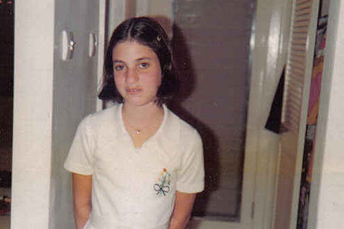 "Susan Davis at about 8-years-old, 1976 -- ""old nose and buck teeth."" At age 12: ""I managed to gather a bunch of photographs of myself. I stabbed myself through the face in every one of those photographs with scissors or a knife -- I don't remember exactly -- stabbing and stabbing and stabbing.""                                             (Courtesy Susan Davis)"