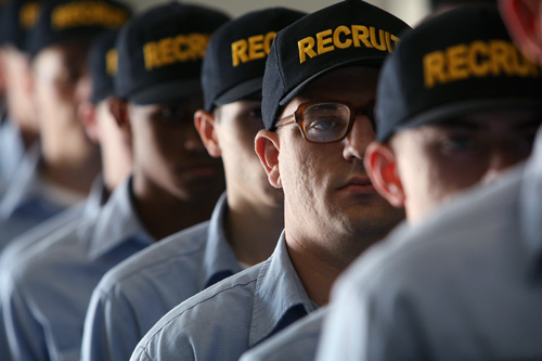 U.S. Navy recruits stand at attention during training at The Great Lakes Recruit Training Command in North Chicago, Illinois. More than 40,000 recruits complete eight weeks of training at the facility every year. The base, which opened in 1911, was the first and is the only remaining U.S. Navy boot camp.                                             (Scott Olson/Getty Images)